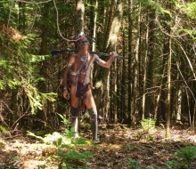 Nissowaquet, a Native warrior, awaits in the woods